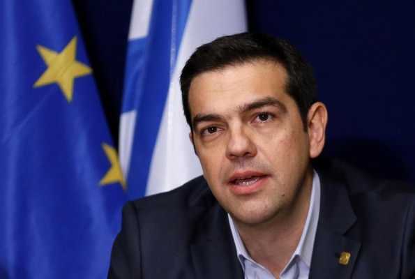 Greek Prime Minister Alexis Tsipras addresses a news conference after a European Union leaders summit in Brussels February 12, 2015. Tsipras said on Thursday his goal was a transition to a new financing programme and that he had made progress at his first European Union summit. Picture taken February 12, 2015. REUTERS/Francois Lenoir (BELGIUM - Tags: POLITICS BUSINESS HEADSHOT)